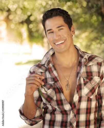 Guy smiling outside