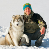 young man with husky dog