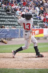 baseball player swinging