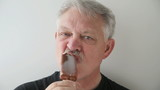 front view of man eating ice cream bar