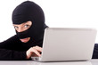 Hacker with computer wearing balaclava