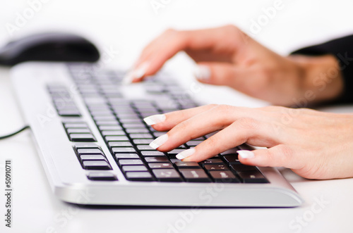 Hands working on the keyboard