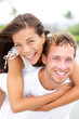 Couple happy having fun piggybacking