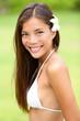 Bikini girl wearing Hawaiian flower smiling fresh