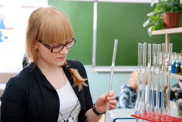 Student with glasses in  laboratory
