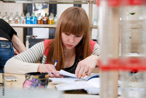 A student at work in laboratory of chemistry studies the records