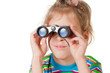 A girl looking through a small binocular isolated