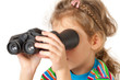 A girl looking through inverted binocular isolated