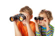 Brother and sister watching through binoculars on white