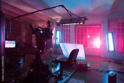 Leinwandbild Motiv room in the purple light with equipment for a film