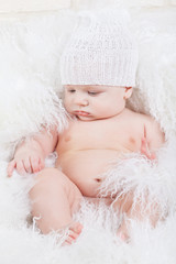 Portrait of a baby in white hat