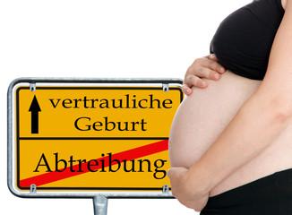 schwangere Frau und Schild - vertrauliche Geburt