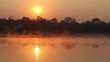 Sunrise at Kavango river and mist on surface, Caprivi. Namibia