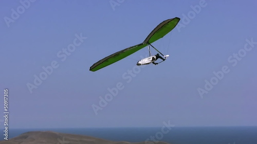 Hangglider in the blue sky