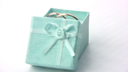 Wedding rings in a green box