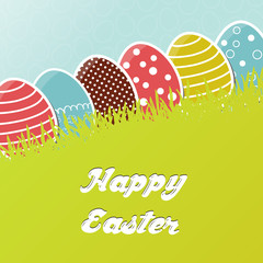 Card with colorful Easter eggs in grass