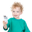 young boy with remote control. Isolated on a white