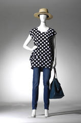 full-length mannequin blue dressed in jeans with bag