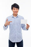 Young asian man showing empty card.