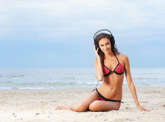 Young, healthy, beautiful and sexy woman listening to the music
