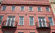 Black Iron Balconies on Red Plaster Building