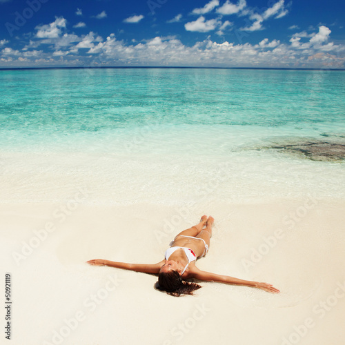 Cute woman relaxing on the tropical beach