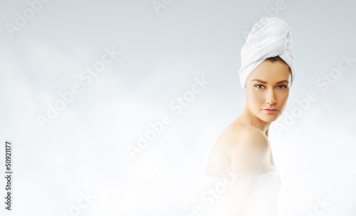 Pretty woman in steam bath. Closeup