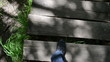 man legs with black shoes go down on old wooden stair in park