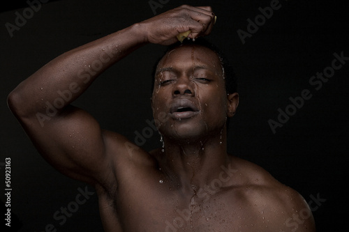 Portrait of a Man Washing Face with Water