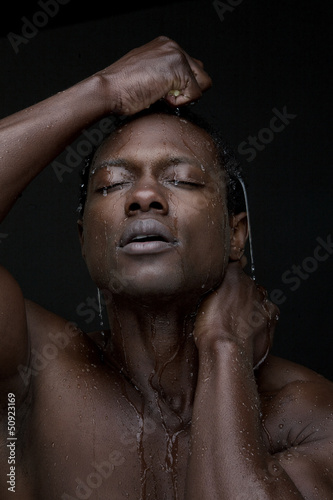 Portrait of a Black Man with Water on Face
