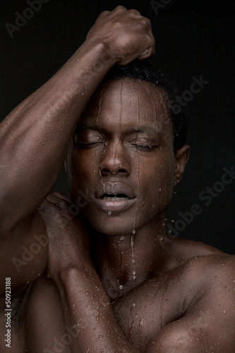 Portrait of a Man with Water on Face