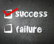 Success and failure handwritten with white chalk on a blackboard