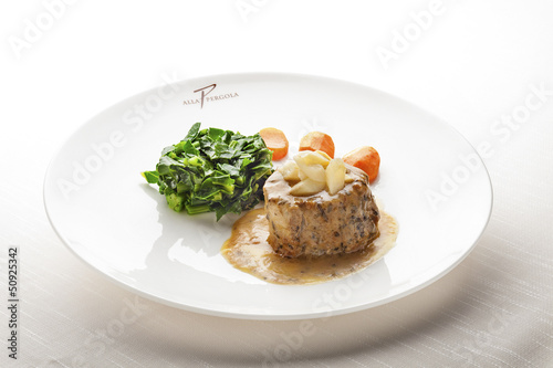 Juicy Fillet Mignon served with Sauce and Vegetables