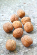 Walnuts on stony background