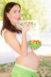 Pregnant girl having breakfast