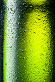 Green bottle with drops. Abstract background