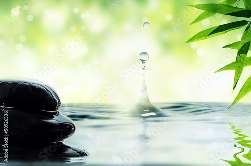 Pebbles, bamboo and drop of water.