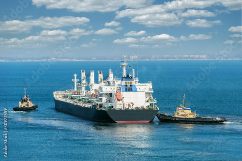 cargo ship and tug boat