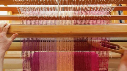 Weaving tea towels on a loom