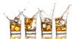 Whiskey glasses with splash, isolated on white background