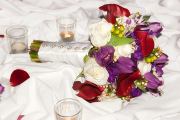 Beautiful wedding bouquet against white decorated table