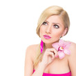 Gorgeous young blonde woman with pink orchid flower