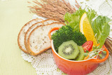 fusion food, fruit and vegetable salad in colorful cup with whol poster