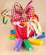 Color bucket with multicolor ribbons and thread