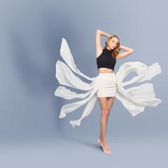 Beautiful woman in a fashionable dress