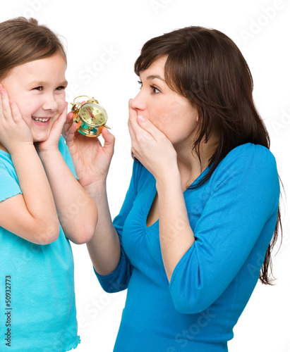 Little girl and her mother are anxious about time