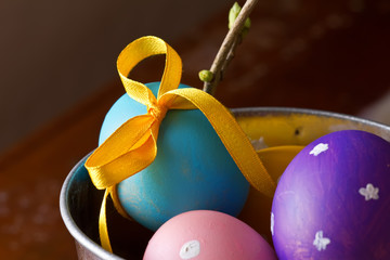 Easter eggs  in bucket on wooden background