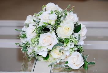 Brides bouquet and grooms buttonhole