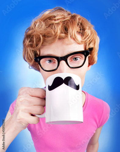 Funny nerdy guy drinking tea