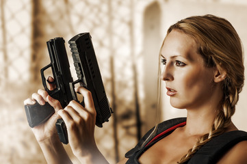 Sexy beautiful woman with guns